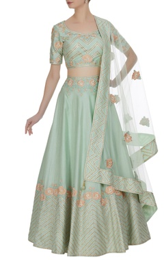 Matsya Embroidered lehenga with choli and parsi dupatta.