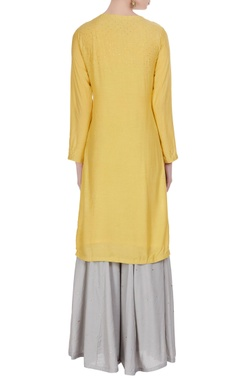 Cotton silk kurta with sharara pants and dupatta.