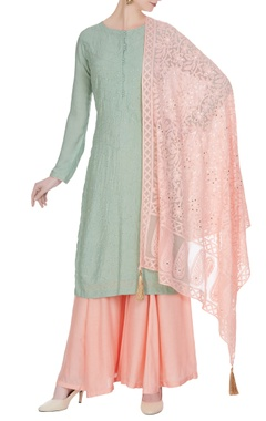 Matsya Pastel shaded kurta with sharara pants and threadwoven dupatta.