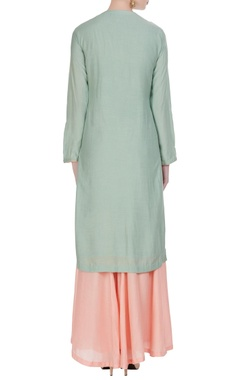 Pastel shaded kurta with sharara pants and threadwoven dupatta.