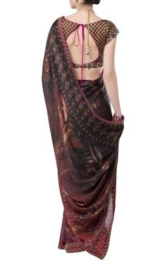 Printed sari with brocade border and blouse.