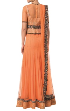 Peplum style blouse with embroidered lehenga and net dupatta