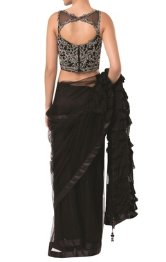 Frilly layered pallu saree with embroidered blouse