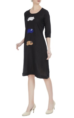 Linen dress with embroidered origami motifs