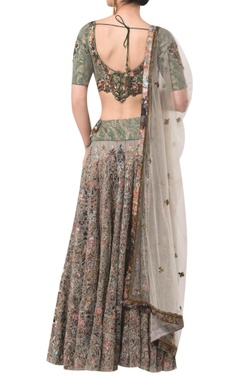 Textured blouse with embellished lehenga and dupatta