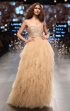 Tulle gown in exaggerated ruffle layers
