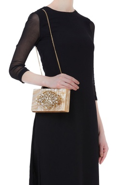 Statement clutch with embroidered strap