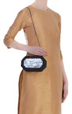 Handmade clutch with crushed metal