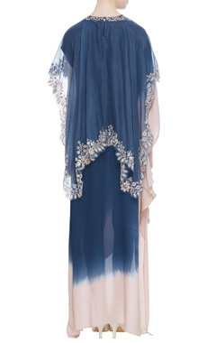 Asymmetric dress with embroidered cape