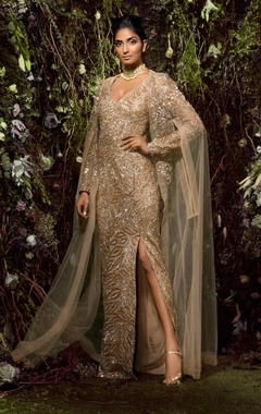 High-slit sequin gown with cape