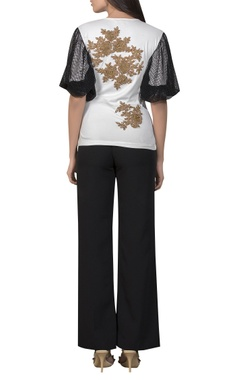 Golden patchwork top with mesh sleeves
