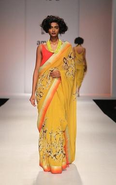 Mustard yellow floral printed sari with orange top