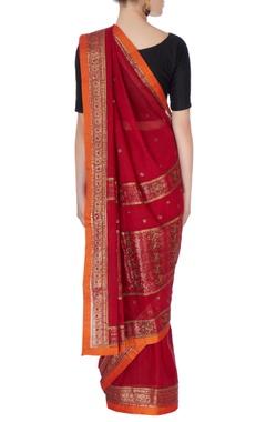 Red sari in mango butta embroidery