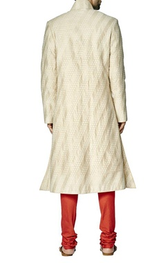 Cream and beige sherwani set with red churidar