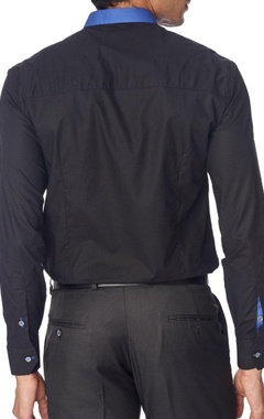 Black shirt with blue patch and collar