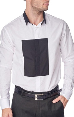 White shirt with black patch