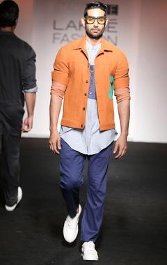 Orange denim jacket with aqua blue patch