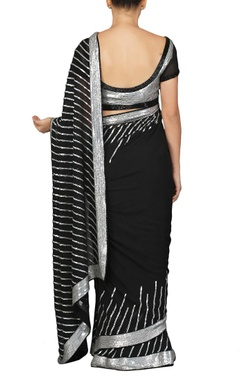 Black and silver sequinned sari