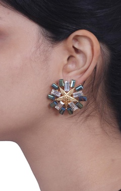 Gold star studded earrings
