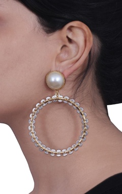 Gold hoop earrings with pearl