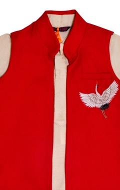 beige kurta with an embroidered red jacket