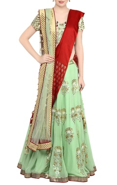 mint green gota patti lehnga with green embroidered blouse.