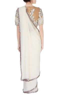 ivory embellished sari with beige blouse