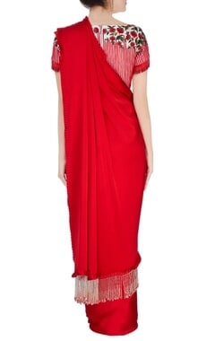 red sari with fringed border and blouse