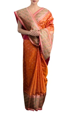 Pinki Sinha Orange sari with multi colored border