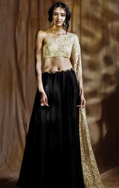 Beige embroidered one sleeved blouse with lehenga