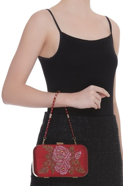 Box clutch with crystal embellished center