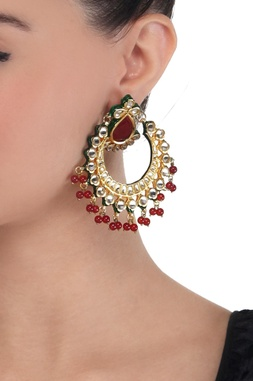 Gold polished kundan and red stone earrings