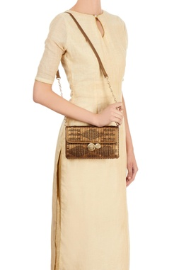 Bronze woven clutch with 3D details