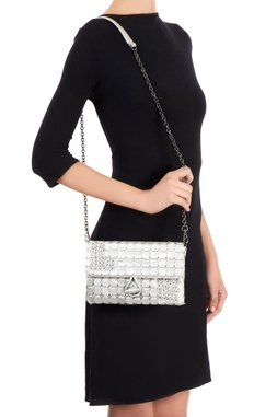 Silver clutch with woven circles embellishment