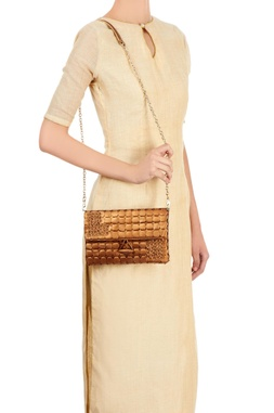 Bronze clutch with woven circles embellishment