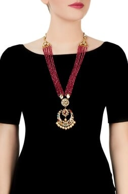 Red beaded necklace with studded pendant