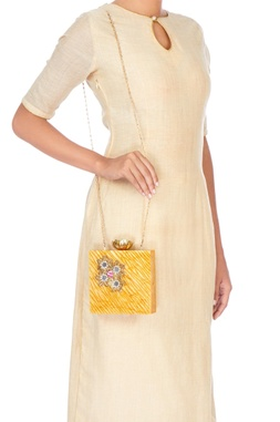 Mustard yellow embellished clutch