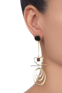 Gold long earrings with black stonework