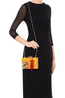 Gold acrylic embellished & tassel clutch