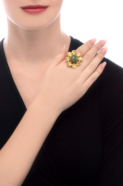 Gold plated beaten ring with green semi-precious stone