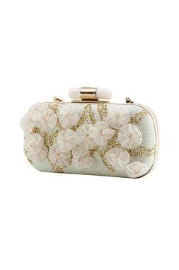 White clutch with embroidery and flowers