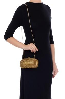Golden metal crystal studded sling bag