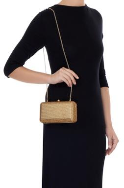 Golden metal box sling bag
