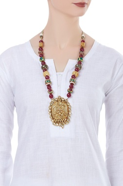 Temple pendant necklace with multifaceted beads