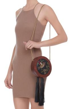 Embroidered tasseled circular bag