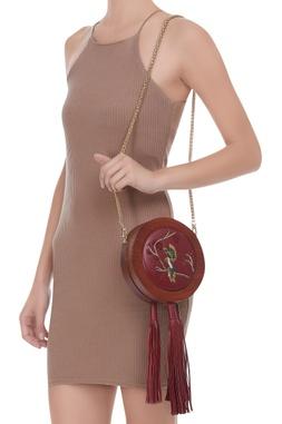 Embroidered tasseled sling bag