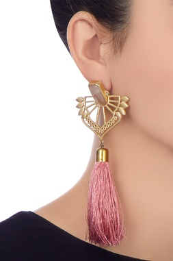 Golden brass cut-out statement earring with pink tassel detail