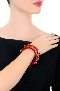 Maroon & gold pair of studded bangles