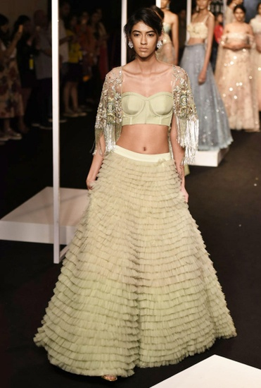 Latest Collection of Sage green lehenga set with cape by Monika Nidhii