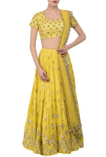 Latest Collection of Lemon yellow & silver embroidered lehenga set by Astha Narang